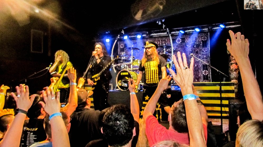 """After tossing out a few guitar picks, drum sticks and yes, bibles, Stryper basks in the cheers after ending with lone encore """"To Hell With the Devil."""""""