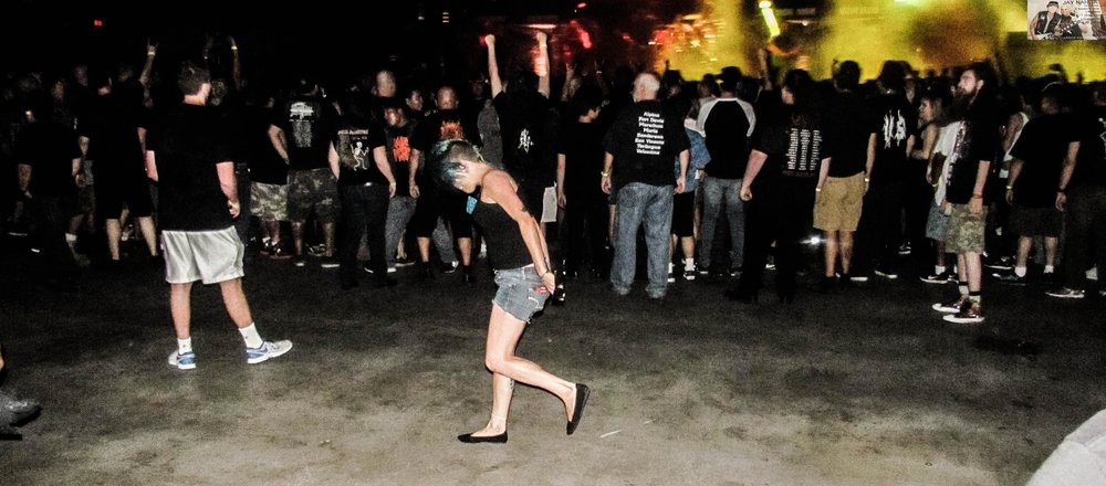 A young female mosher takes to the pits after the guys had cleared it out anticipating the end of Testament's set.