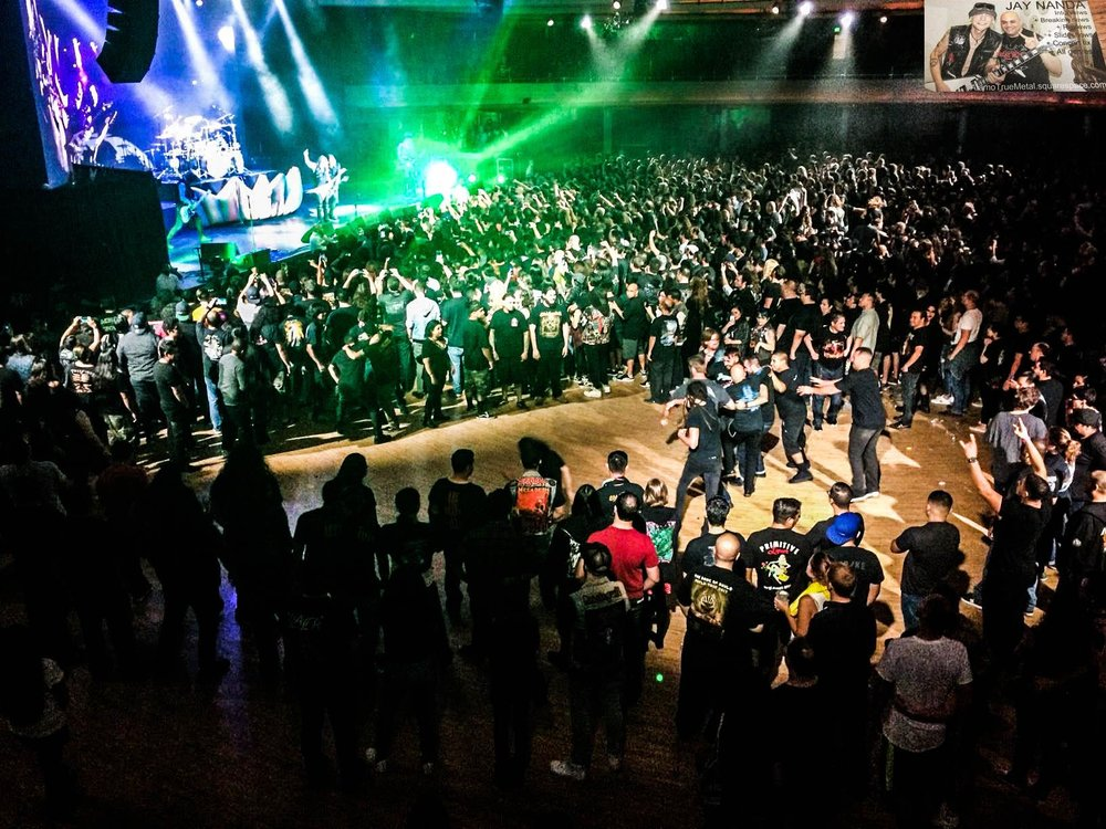 Two mosh pits and friendly dance circles continued strong toward the end of the concert, as seen from the upper level of the Palladium.