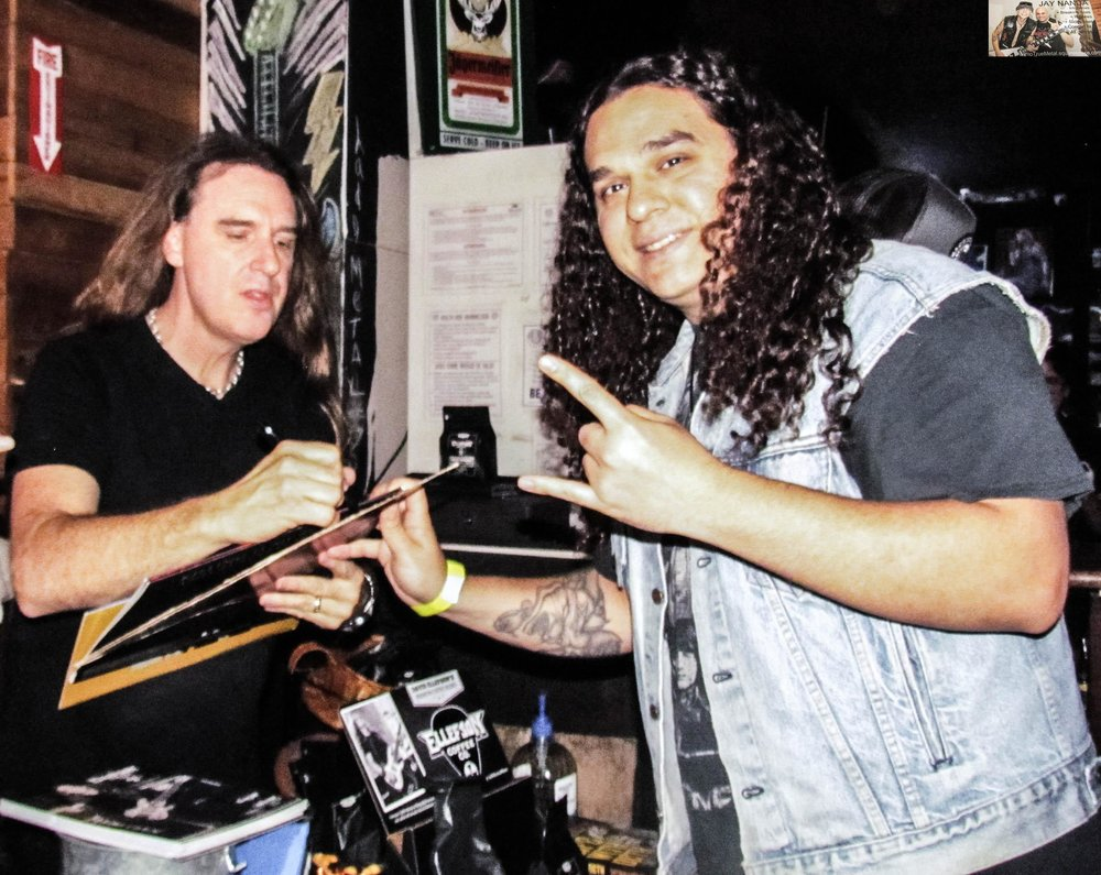 Local fan Ricky Mosh gets an autograph from Ellefson after the set.