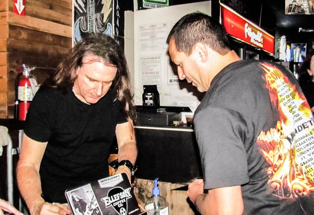 Local fan Bobby Del Bosque has some of his Megadeth albums signed.