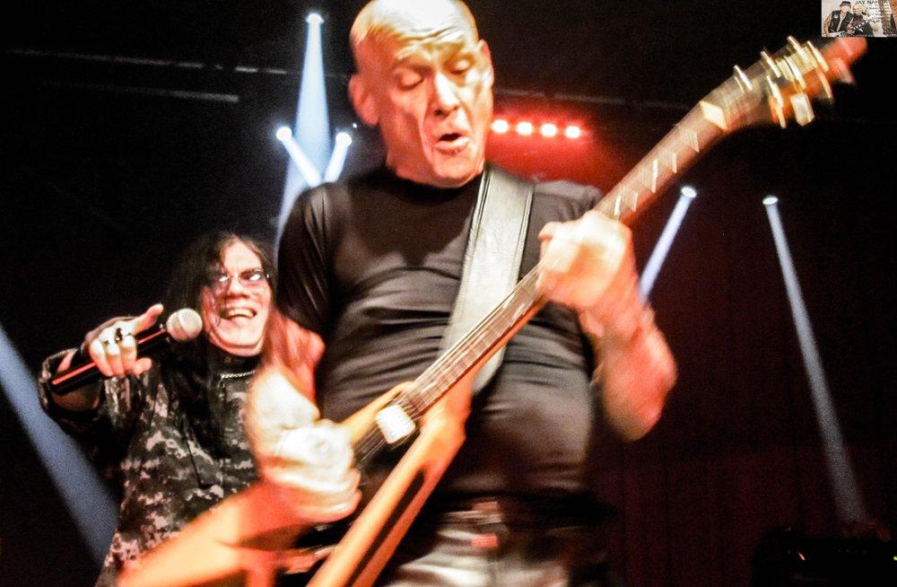 Catlin slays as Rivera admires his guitar work.