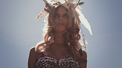 Model with feather head piece - Surf dive & ski Red Ocean Mystics film production, director of photography Toby Heslop