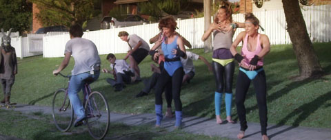 Riding past the girls exercising - Blackbird hum Mad World Film production - Cameraman Toby Heslop