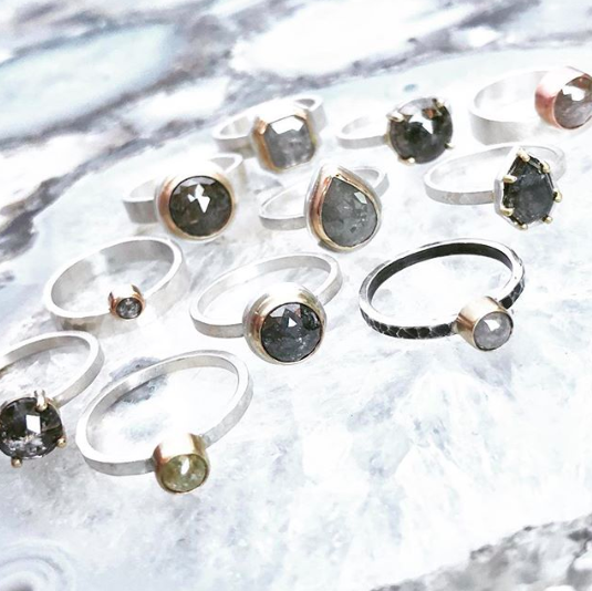 A selection of stackable rings featuring rustic diamonds. Note the range in color from cool gray to nearly black
