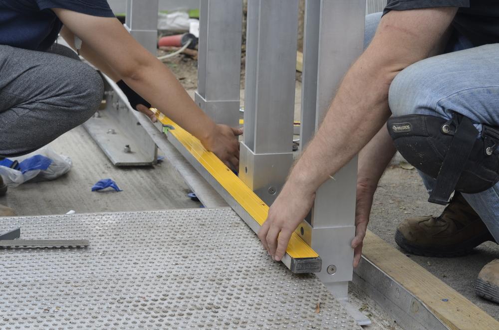 Leveling ADA ramp handrails