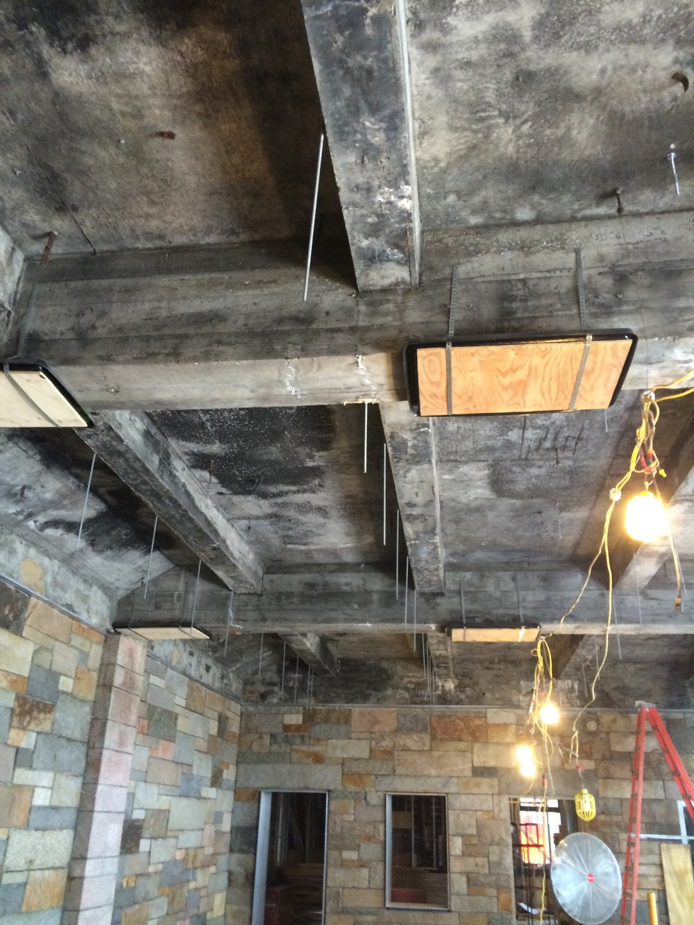 Ceiling rods have been anchored to the beams, ready to receive the ceiling structure.