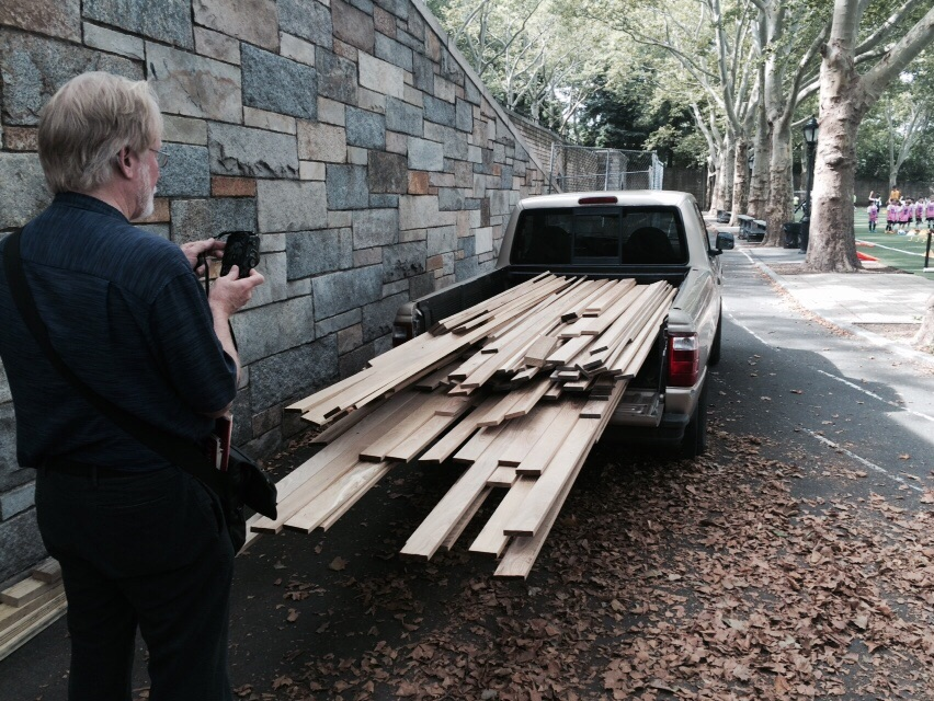 Arrival of black locust wooden planks for bench cladding.