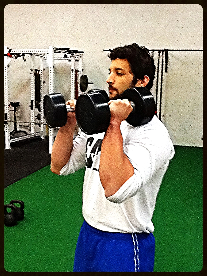 This is the proper way to hold dumbbells when performing Double Arm Racked Squats.