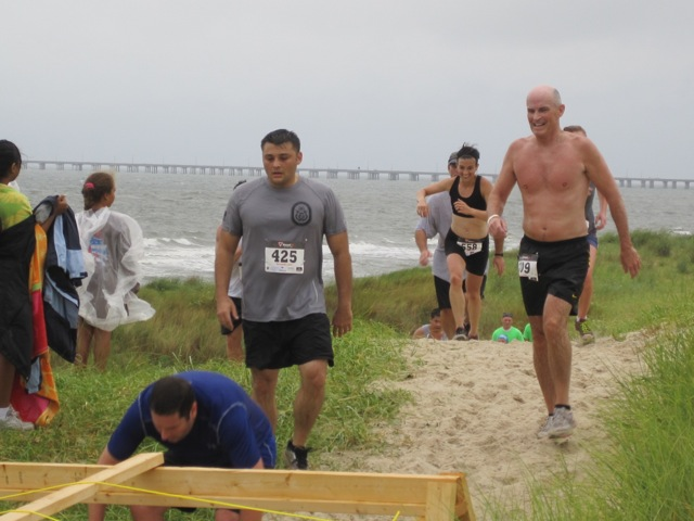 Running up the dunes. See? Choosing to have fun despite how miserable it is to run up multiple sand dunes.