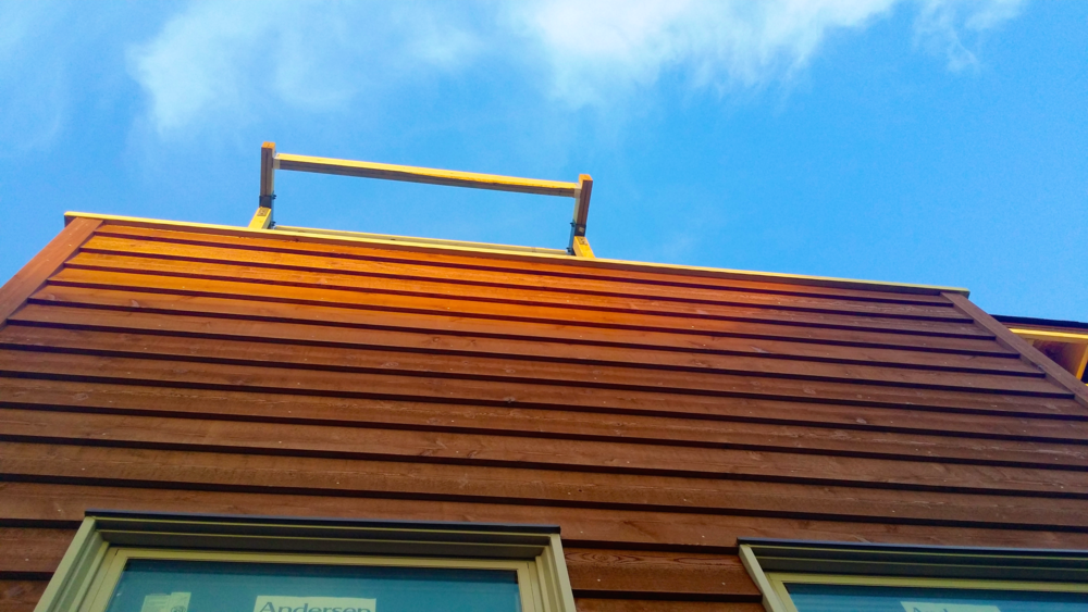 Natural and durable solid Cedar clapboarding finishes key focal points of the facade. Artificial siding can not match its blend of honest beauty and inherent weather resistance.