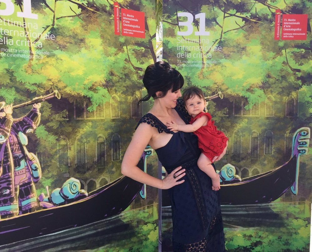 Alice and baby Della (who makes a cameo in the film) on the red carpet.
