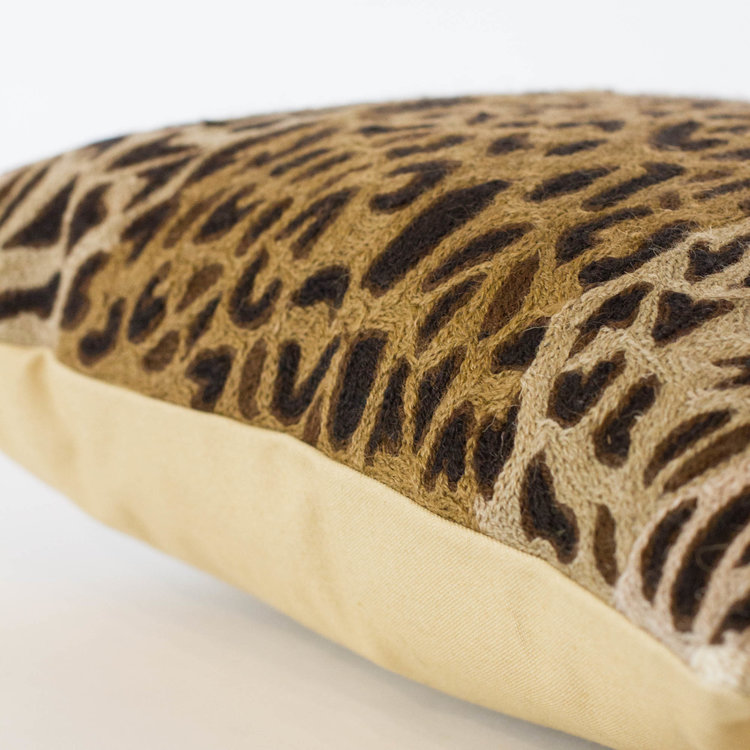 dressed and lined bookmark katana htm kelly lumbar brown soft tufted in with wearstler bed a gibson dana bedding white pillows tall headboard leopard on print pillow bedroom