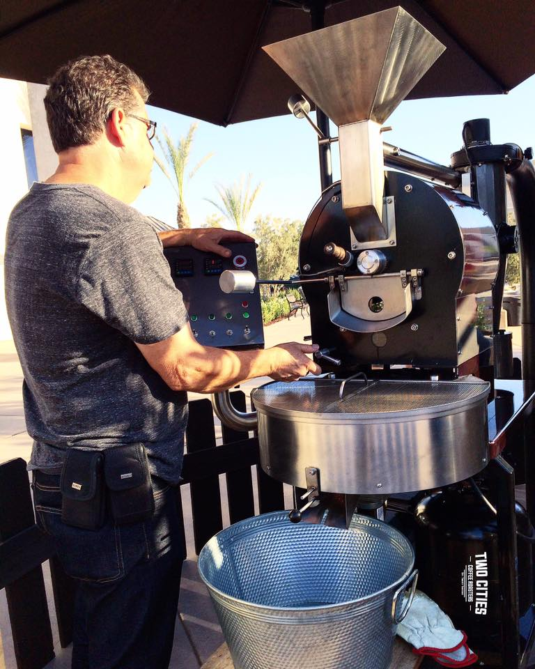 Two Cities' Master Roaster Rick enjoying his love of roasting coffee on the mobile roaster he designed and built himself.