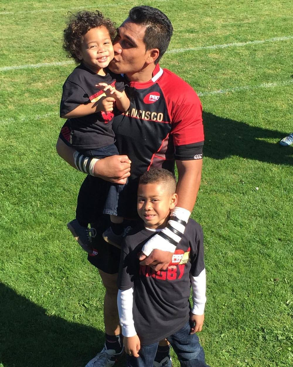Siupeli with his two biggest fans post game.