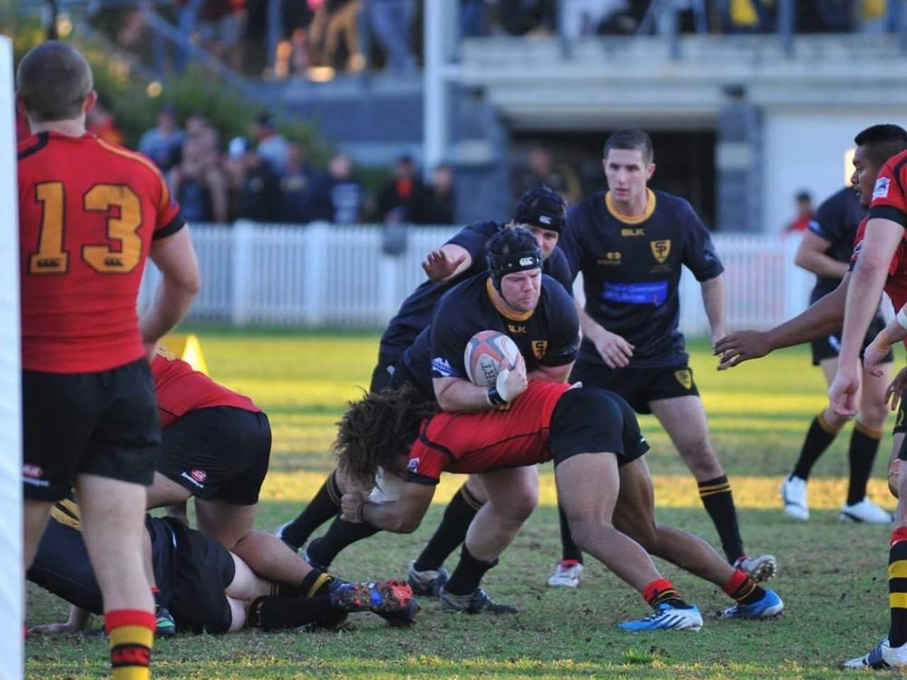 Browden making the tackle while playing with the Dirty Reds (Sydney, Australia).