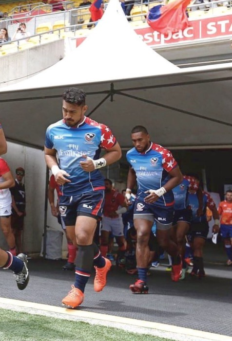 Pago Haini running out the tunnel at the Wellington 7s (2017)