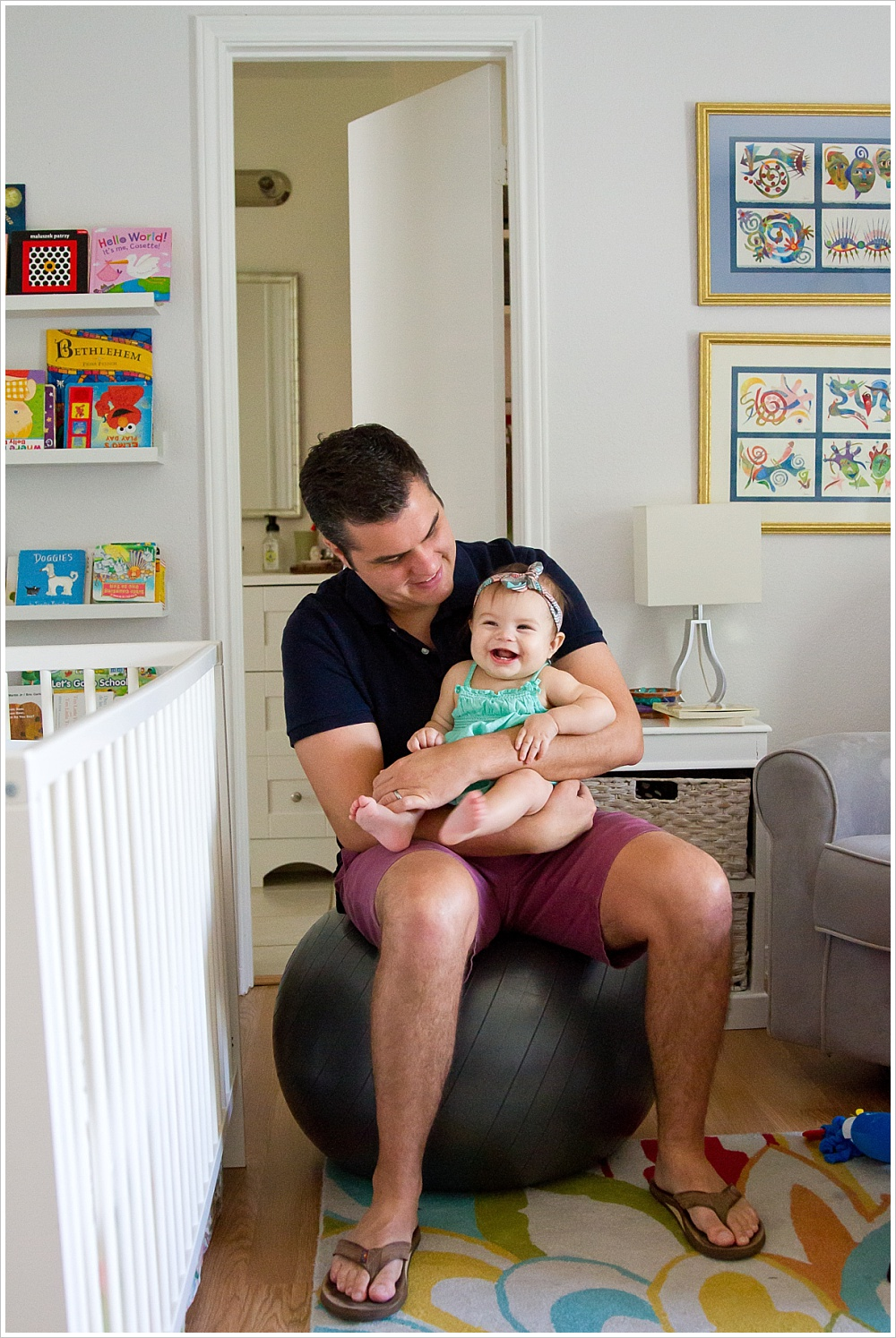 dad bounces baby on a ball | lifestyle family photography in Cedar Park, Texas | Jason & Melaina Photography