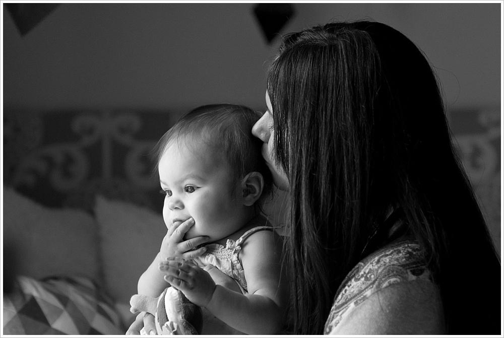 mom kisses baby | lifestyle family photography in Cedar Park, Texas | Jason & Melaina Photography