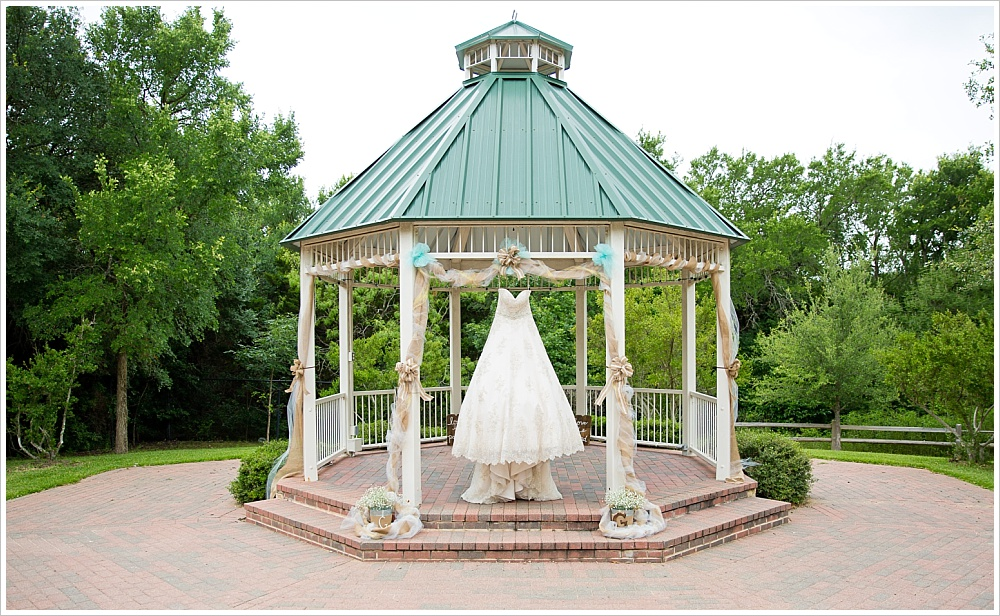 bridal gown hanging in gazebo | Carleen Bright Arboretum wedding venue in Woodway, TX | Jason & Melaina Photography