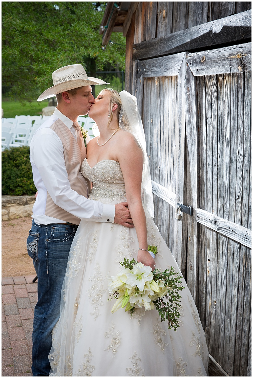 bride and groom kiss after ceremony | Carleen Bright Arboretum wedding venue in Woodway, TX | Jason & Melaina Photography