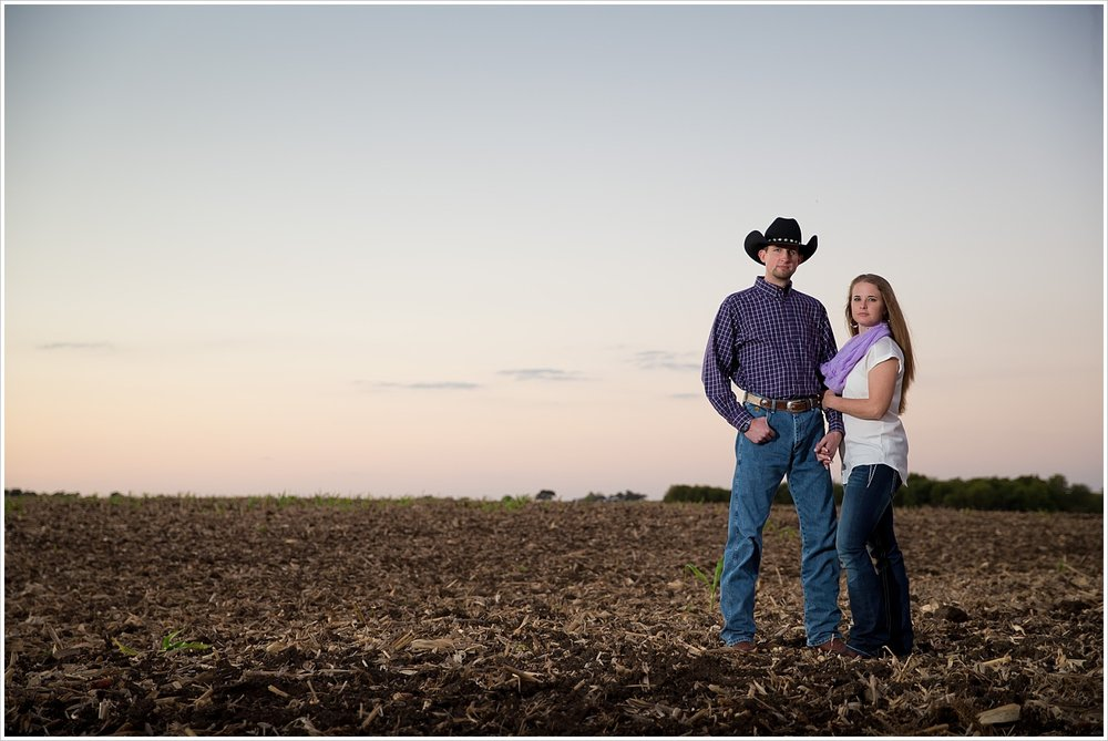 a couple stands in open field | West, Texas Engagement Portraits | Jason & Melaina Photography
