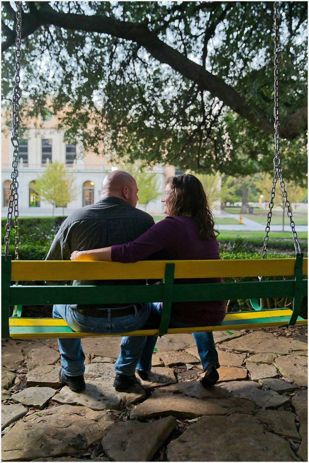 engagement portraits on green and gold swings at Baylor | Waco, Texas | Jason & Melaina Photography
