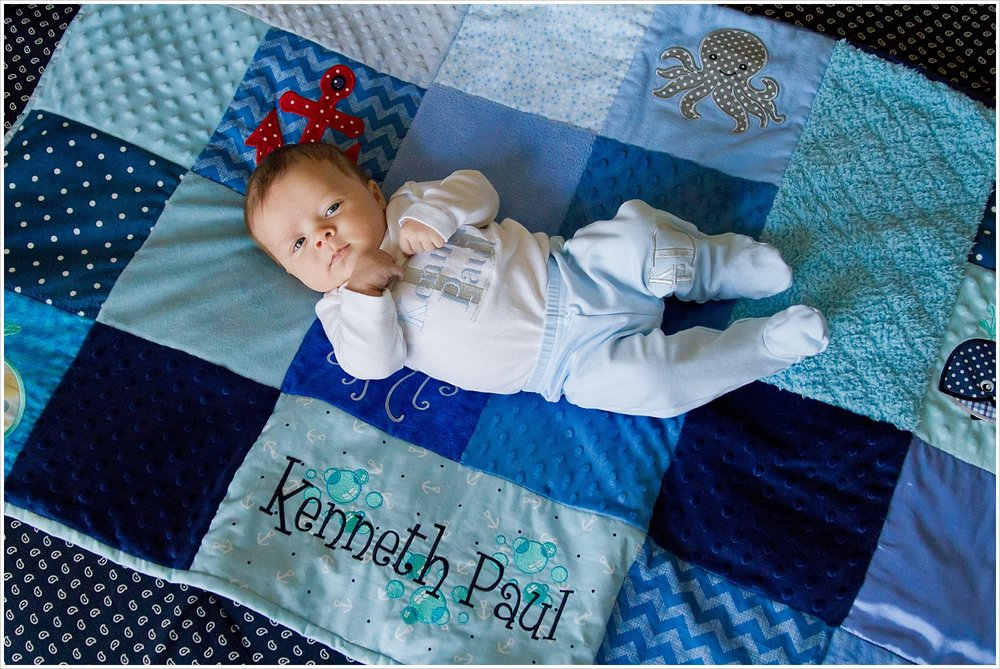 baby lays on homemade quilt | lifestyle family photography in Waco, Texas | Jason & Melaina Photography