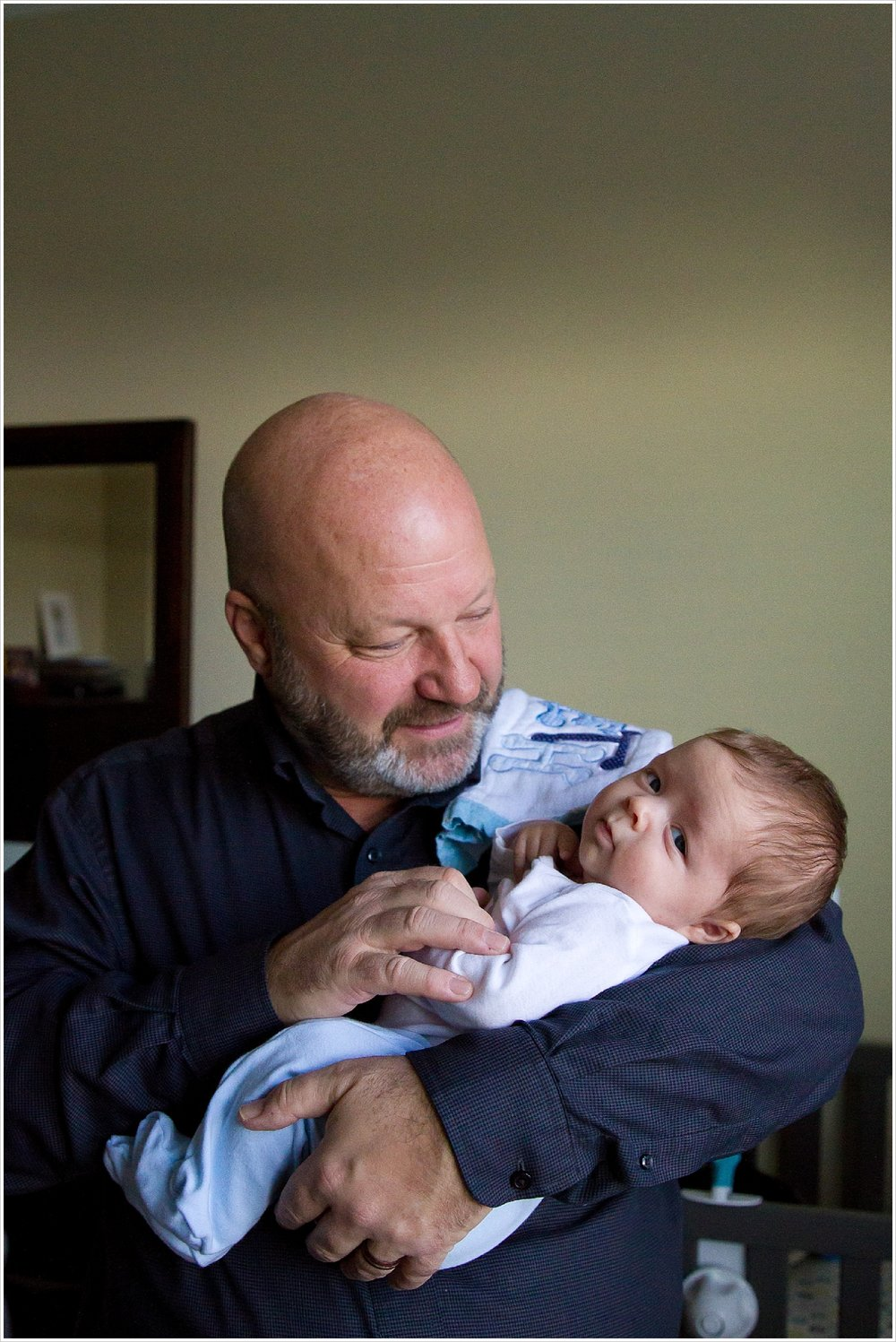 Dad holds baby son | lifestyle family photography in Waco, Texas | Jason & Melaina Photography
