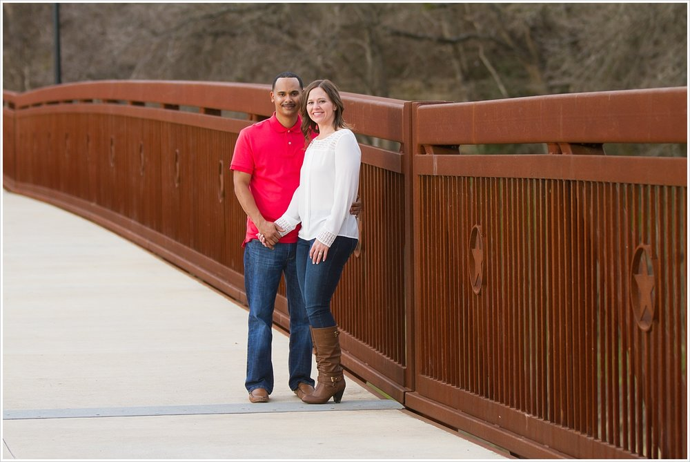 Couple stands side-by-side on bridge in Belton, Texas