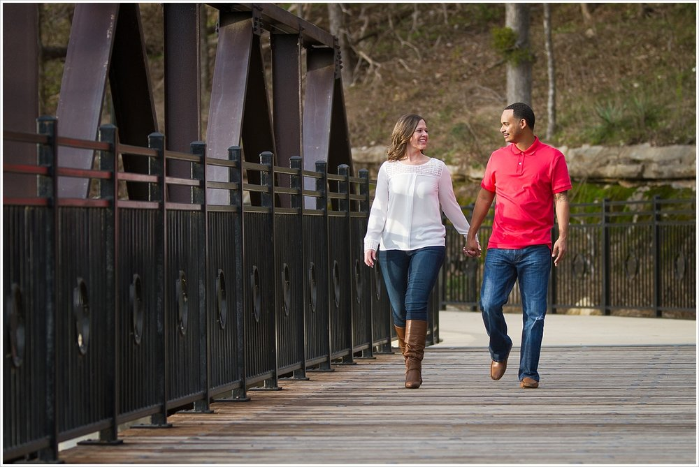 Couple walking together on bridge in Belton, Texas