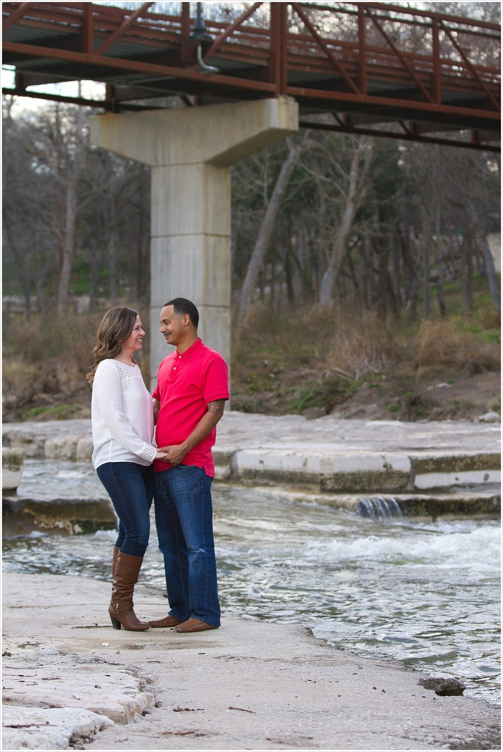 Couple holds hands beside Nolan Creek in Belton, Texas