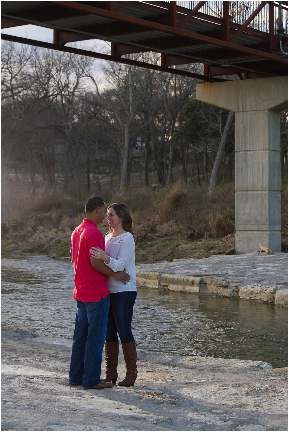 Couple embraces during engagement portraits in Belton, Texas