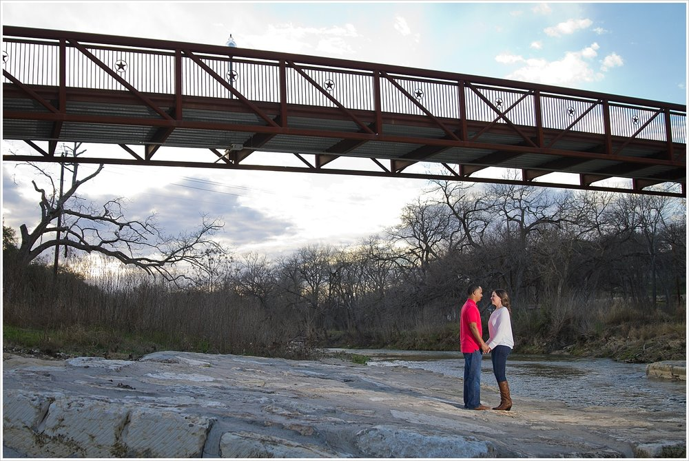 Couple under walking bridge with open sky