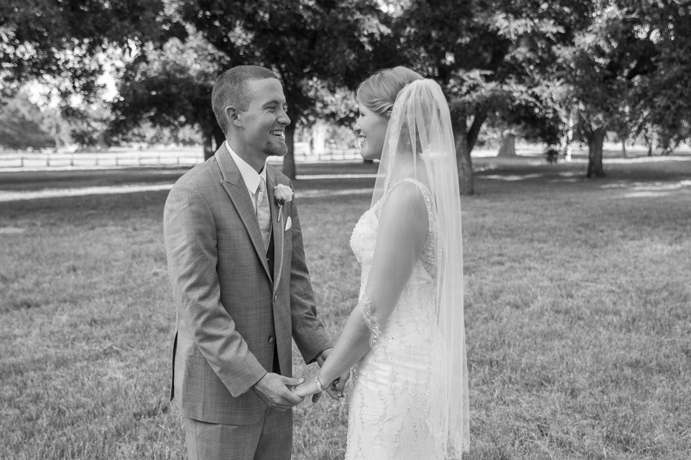 Bride and groom hold hands after their wedding at Moon River Ranch
