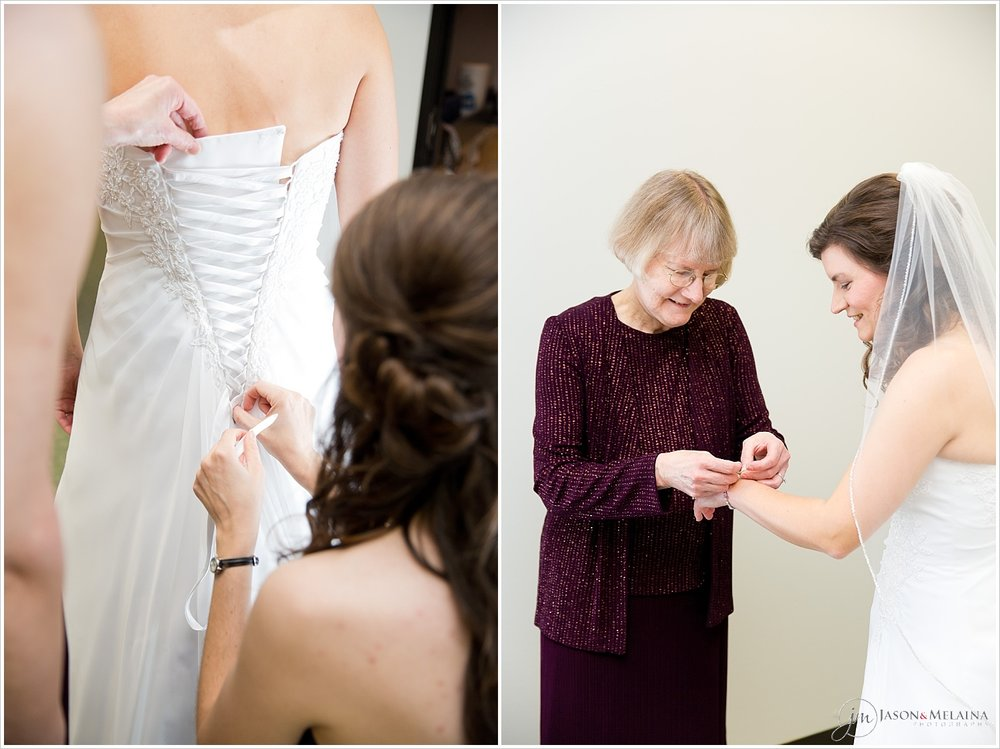 Maid of honor lacing back of bride's wedding dress, bride's mother putting on her bracelet