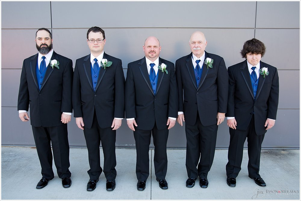 Groom and groomsmen outside Antioch Community Church in Waco, Texas