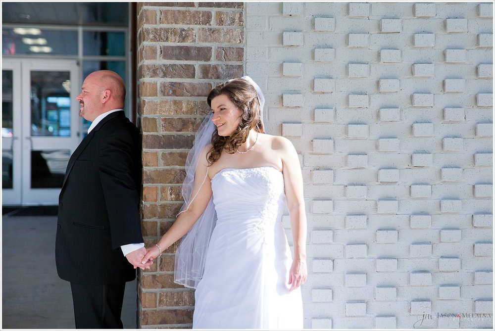 "Bride and groom's ""first touch"" before their wedding ceremony at Antioch Community Church in Waco, Texas"