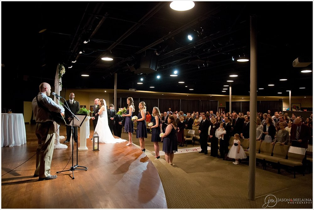 Bridal party and congregation worship during wedding ceremony at Antioch Community Church in Waco, Texas