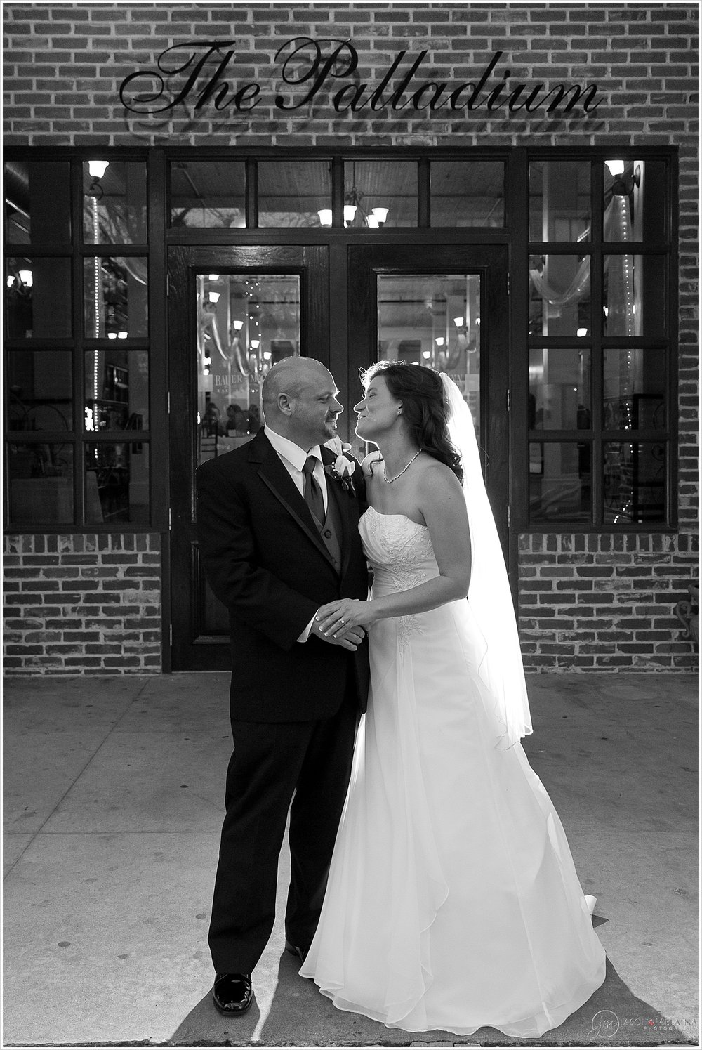 Bride and groom pose in front of The Palladium in Waco, Texas
