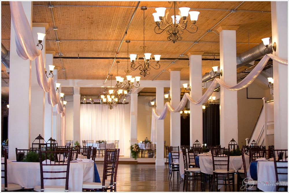White and navy tables with lantern centerpieces inside The Palladium in Waco, Texas