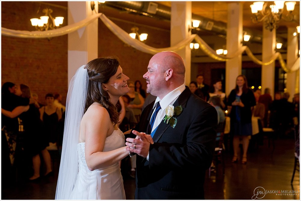 Bride and groom smile during their first dance, The Palladium, Waco, Texas