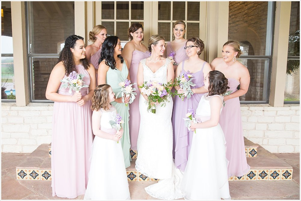 Bride and bridesmaids together on steps of porch at La Rio Mansion