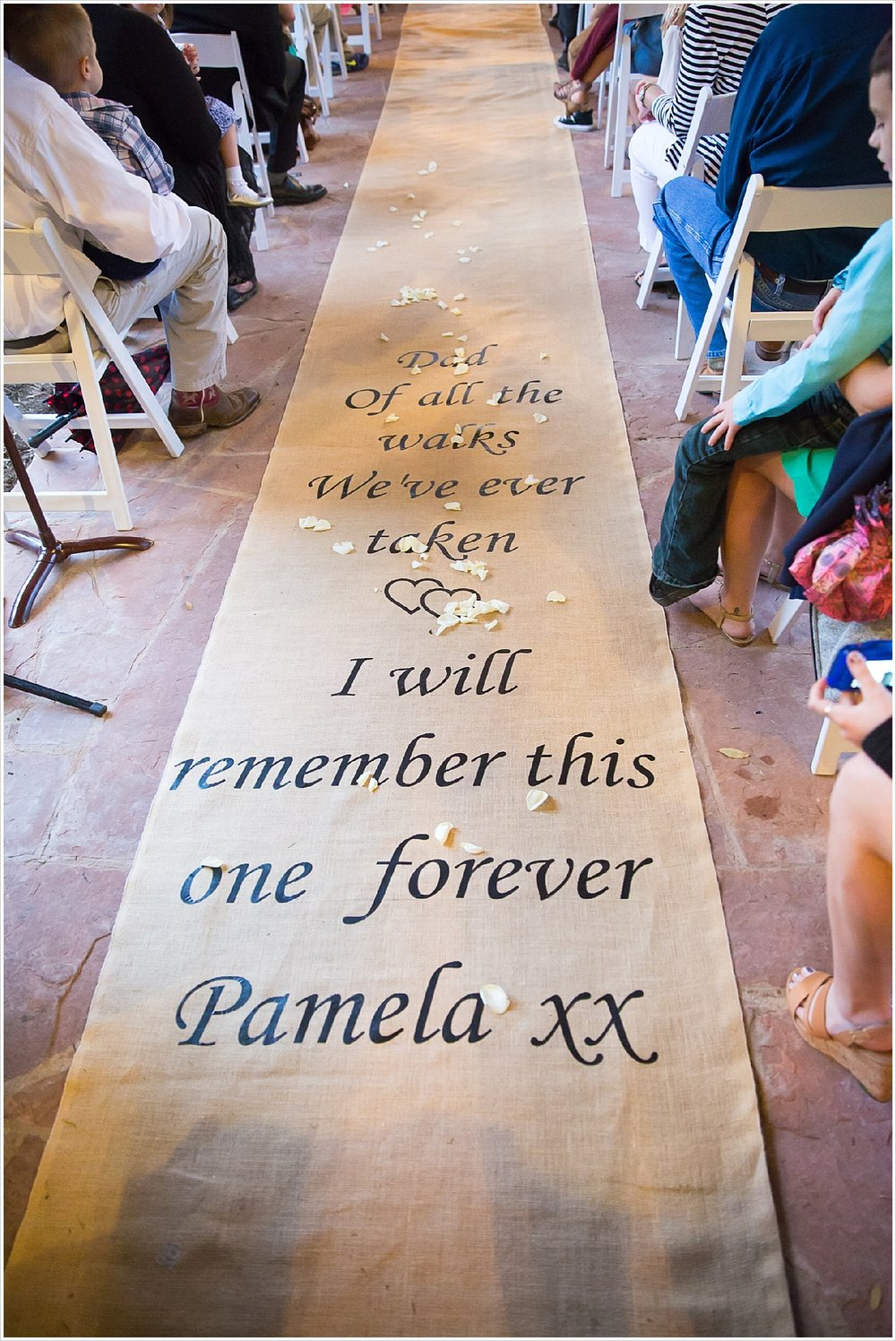 "Aisle runner which says, ""Dad, of all the walks we've taken, I will remember this one forever"""