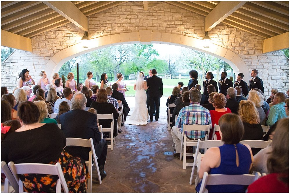 Rainy wedding ceremony under covered driveway at La Rio Mansion in Belton, Texas