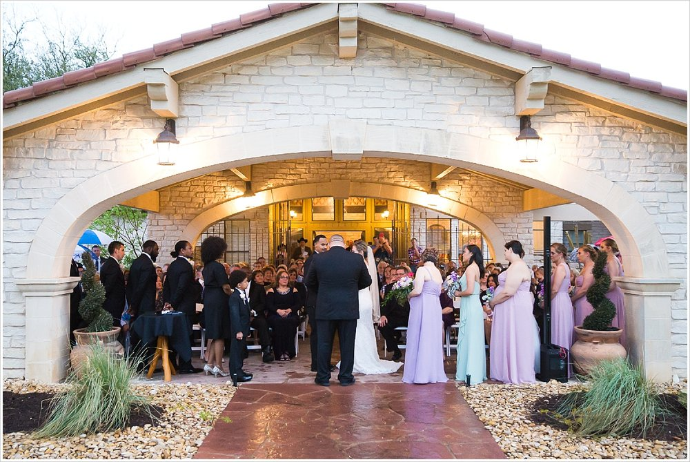 Wedding ceremony during rainstorm at La Rio Mansion in Belton, Texas