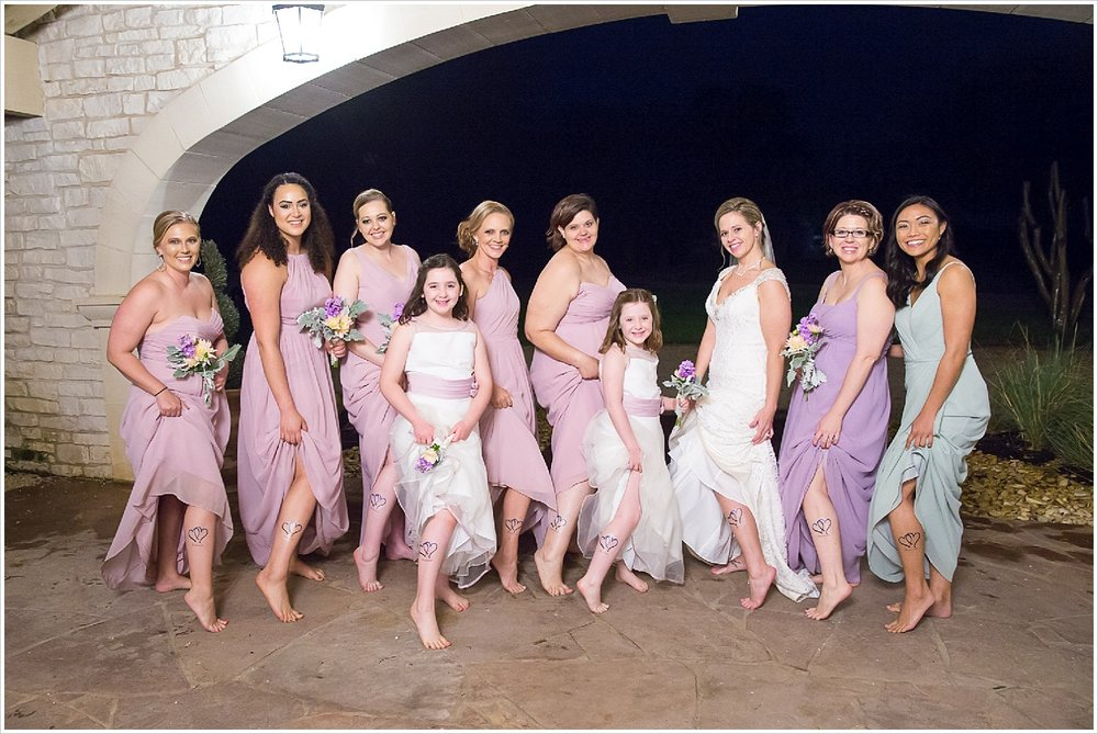 Bride and bridesmaids show off matching temporary tattoos