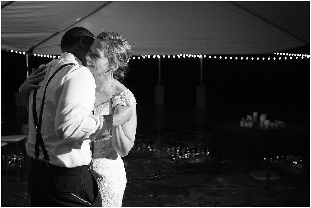 Bride and groom's first dance during rainy evening reception at La Rio Mansion