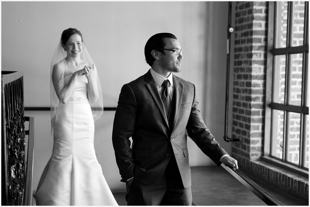Bride approaches a groom from behind for a first look, The Palladium in Waco, Texas