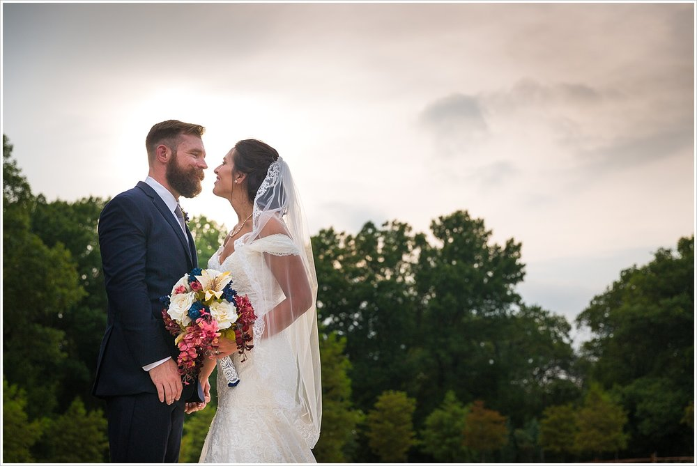 Groom & Bride with cloudy sky behind them, summer blush and navy wedding at Stone Hall at The Springs in McKinney, Texas, Jason & Melaina Photography, www.jasonandmelaina.com